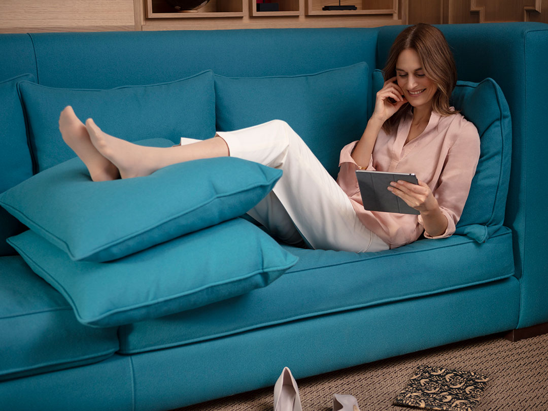 Woman on sofa with legs elevated
